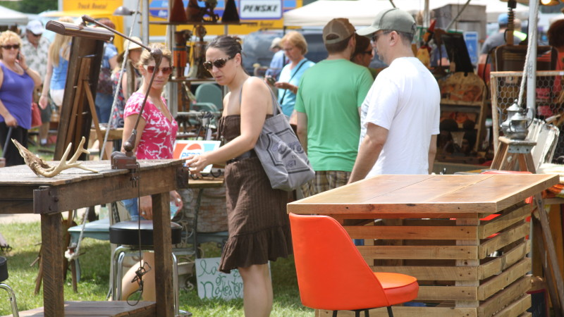 How can I sell at the Michigan Antique Festival?